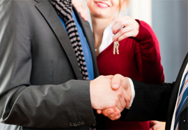 Landlord and tenant shake hands over new tenancy