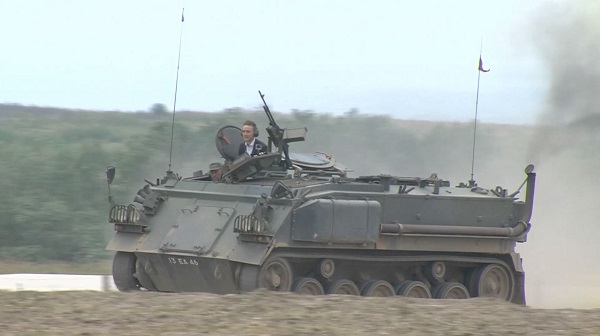 Charlie driving a tank