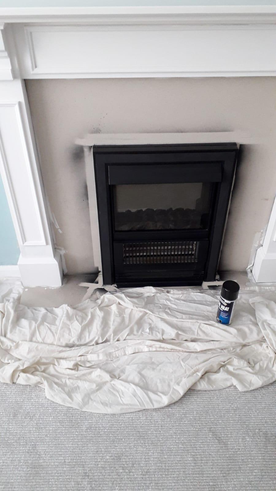 Applying heat proof black spray