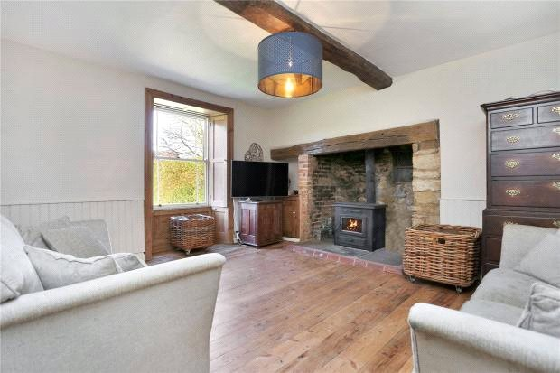 An elegant and charming farmhouse dating back to the mid-18th century with nearly a half acre plot