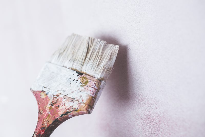 Paintbrush on a white wall